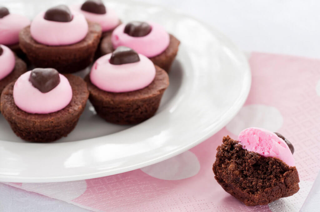 Plate full of brownies decorated for Valentine's Day with one half brownie on the side.Similar Images: