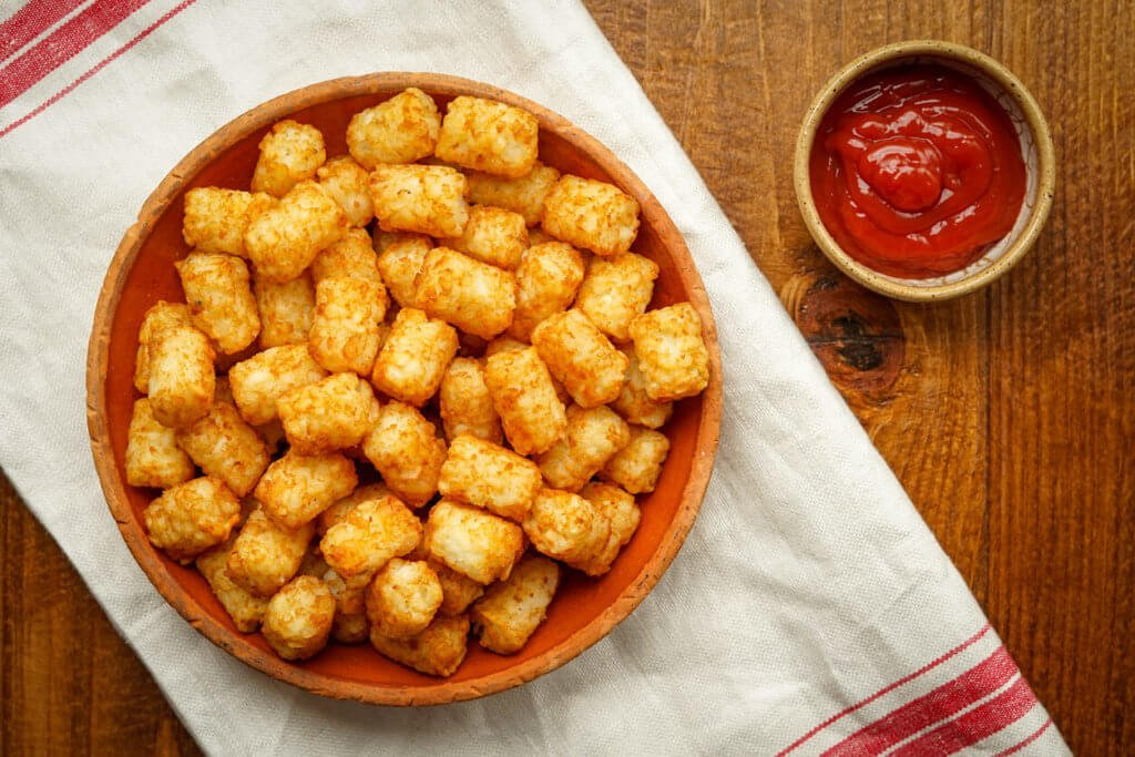 Tater tots with ketchup on the side