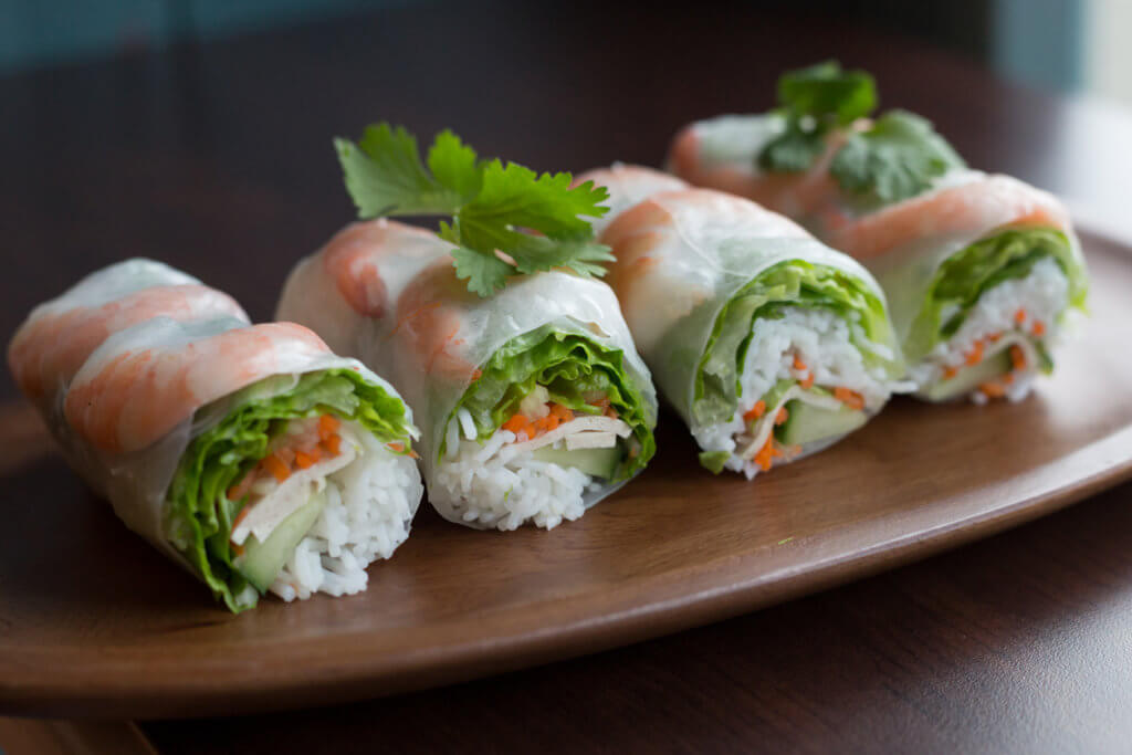 A healthy summer roll filled with healthy veggies and shrimp.