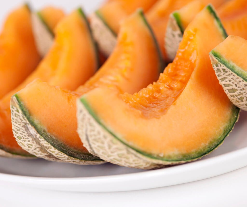 Portions of Cantaloupe on plate.
