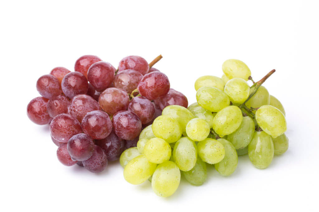 A bunch of green and red grapes.